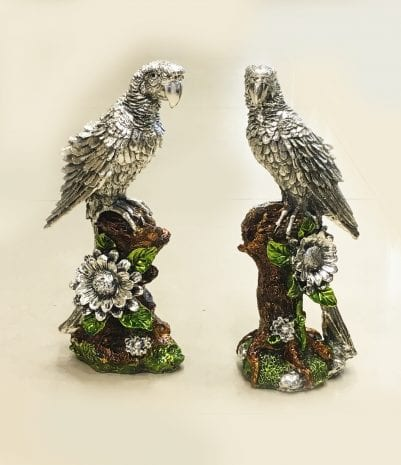 Artistic Silver Parrots Pair sitting on a tree Trunk. 11.5″ – Resin Silver