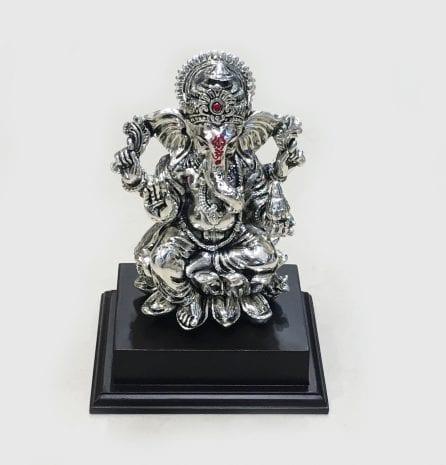 Silver Ganesha on a Wood pedestal 7.5″- Resin Silver