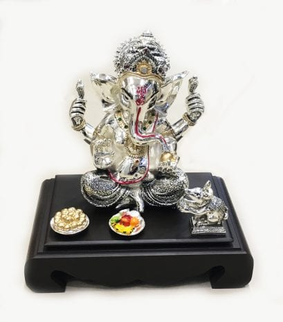 Gorgeous Silver Mukut Ganesha set on a wooden chowki, 10.5″ – Resin Silver