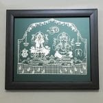 Silver Foil Laxmi Ganesha with Price set on a Wood finish frame – 9.5 Inch Long  Frame